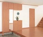 作りつけのたっぷり収納と大きな姿見が玄関をすっきりまとめて見せてくれます。
